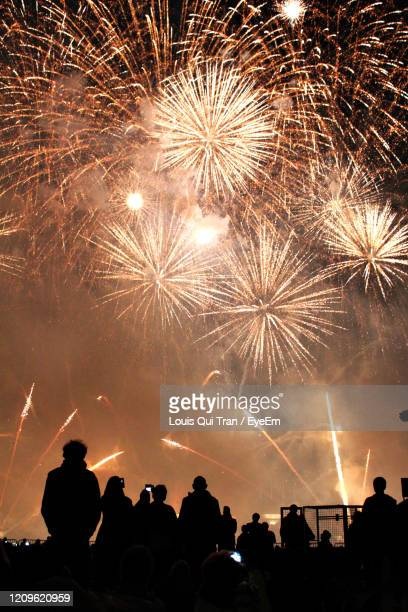 firework display at night - olympiastadion berlin stock pictures, royalty-free photos & images