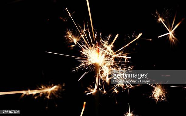 firework display at night - diwali stock photos and pictures