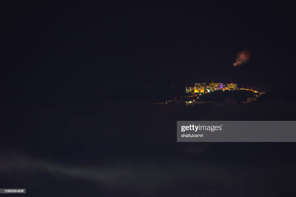 Firework display at top of the mountains during 2019 new year's eve celebration. : Stock Photo