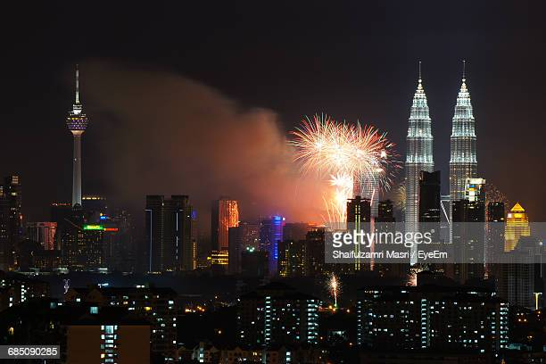 firework display by petronas towers and buildings in city - shaifulzamri stock pictures, royalty-free photos & images