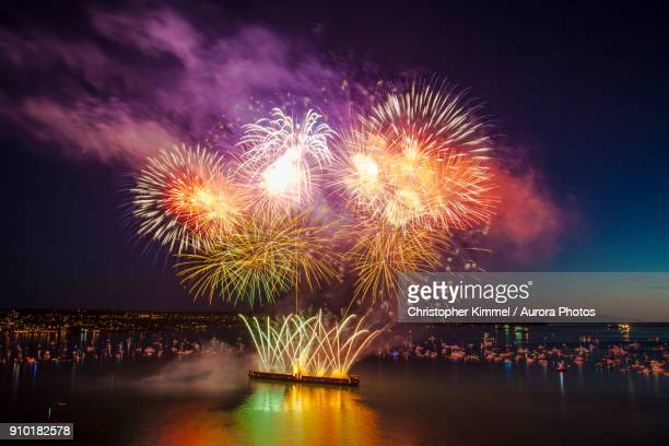 firework display during celebration of light at english bay, vancouver, british columbia, canada - english bay stock photos and pictures