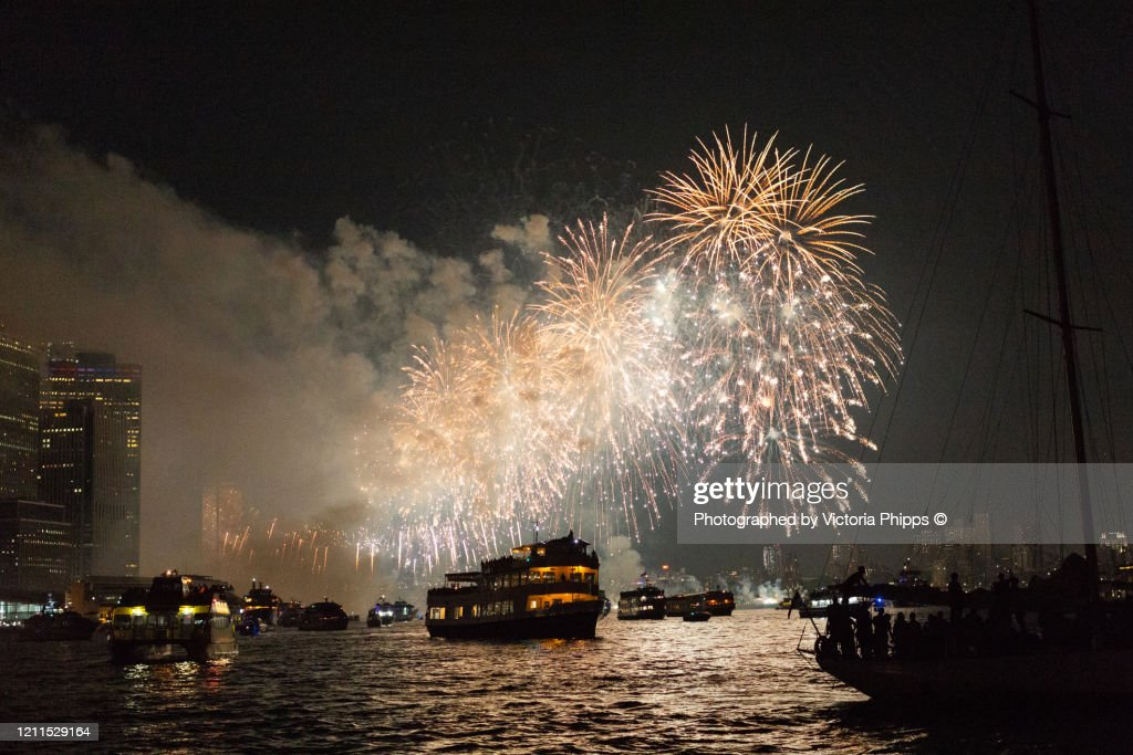 Firework display in New York Bay with boats in the foreground : ストックフォト
