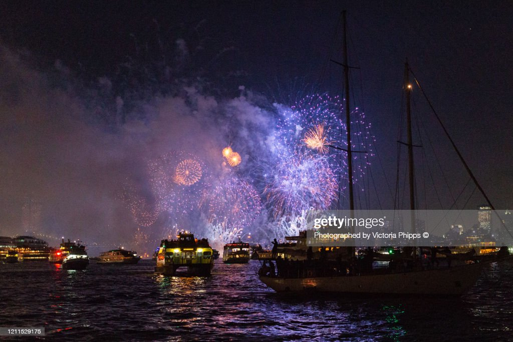 Firework display in New York Bay with boats in the foreground : Stock Photo