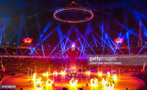 TOPSHOT A firework display is seen during the opening ceremony of the Pyeongchang 2018 Winter Olympic Games at the Pyeongchang Stadium on February 9...