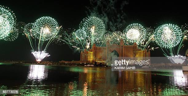 A firework display lights up the sky around the Atlantis Hotel during the official grand opening party on the Palm Jumeirah in Dubai on November 20...
