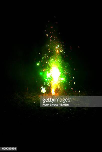 firework display on field at night - frank swertz stockfoto's en -beelden