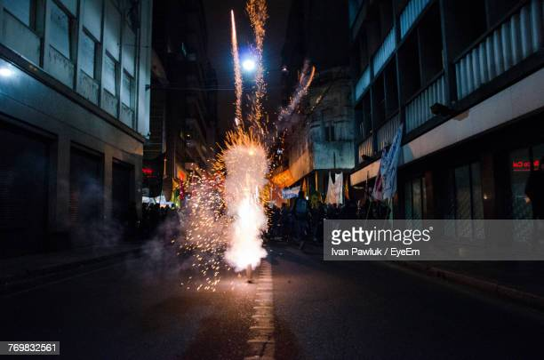 Firework Display On Street In City At Night