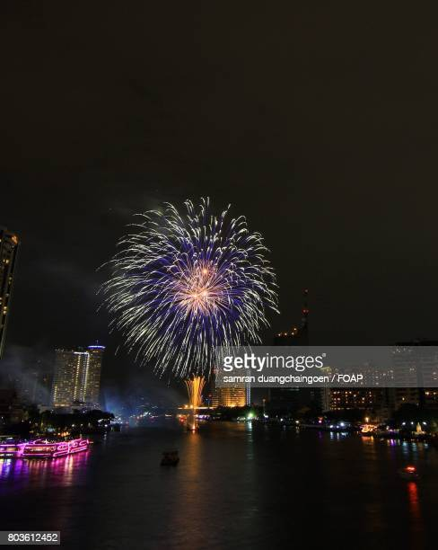 Firework display over a city at night