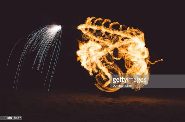 firework display over black background - bortes fotografías e imágenes de stock