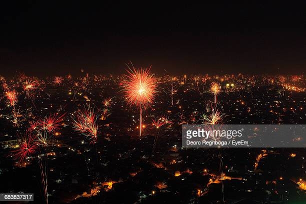 Firework Display Over City During New Year Eve