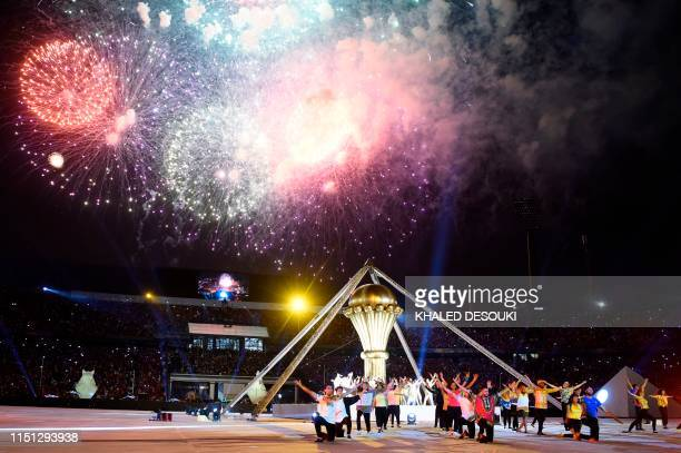 Firework explodes in the sky as performers take part in the opening ceremony of the 2019 Africa Cup of Nations ahead of the football match between...