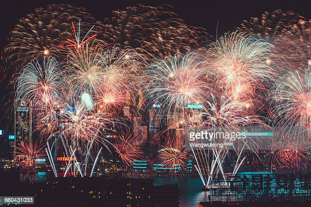 firework frenzy in victoria harbour - hong kong victoria harbour stock pictures, royalty-free photos & images