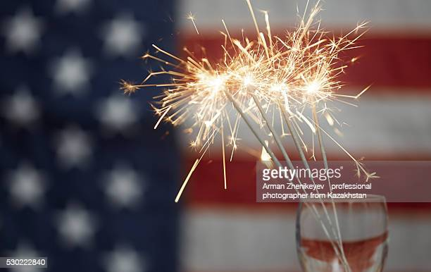 Firework in front of American flag