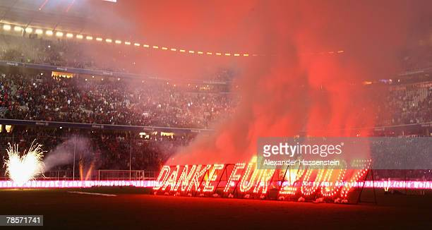 A firework in letters read as thanks for 2007 is seen after the UEFA Cup Group F match between Bayern Munich and Aris Saloniki at the Allianz Arena...