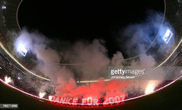 A firework in letters read as 'thanks for 2007' is seen after the UEFA Cup Group F match between Bayern Munich and Aris Saloniki at the Allianz Arena...