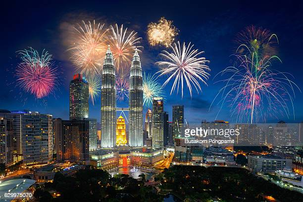 firework over kuala lumpur city, malaysia skyline - national holiday stock pictures, royalty-free photos & images