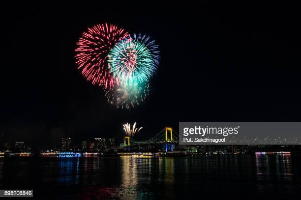 firework over rainbow bridge - 花火大会 ストックフォトと画像