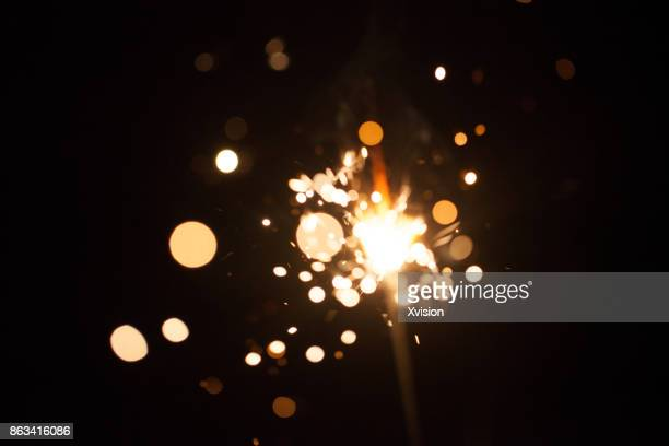 firework spark in high speed with black background - blendenfleck stock-fotos und bilder