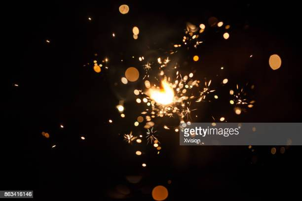 firework spark in high speed with black background - shiny stock pictures, royalty-free photos & images