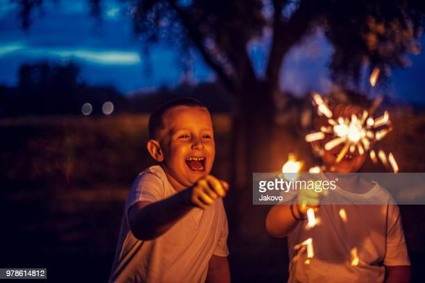 firework sparkles in the night - sparkler stock pictures, royalty-free photos & images