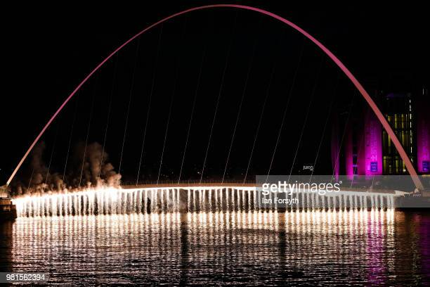Firework waterfall cascades from the Millenium Bridge on the River Tyne during the opening ceremony of the Great Exhibition of the North on June 22,...