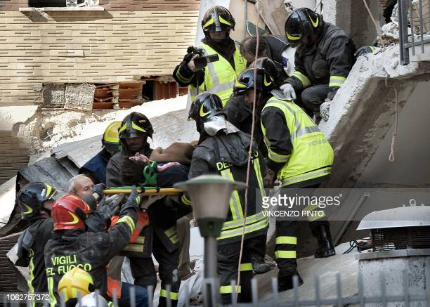 Fireworkers rescue a student from the student's house in L'Aquila on April 6, 2009. A powerful earthquake jolted central Italy on Monday, devastating...