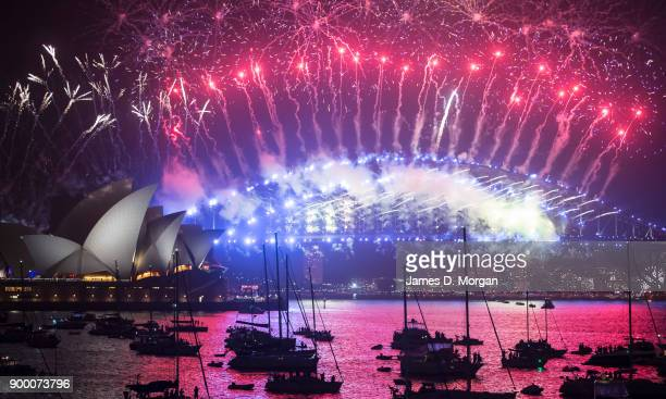 Fireworks above the Opera House and Harbour Bridge for New Year's Eve on January 1 2018 in Sydney Australia Over a million people gathered around the...