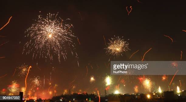 Fireworks after people flying kites on the occasion of Makar Sakranti at wall city of Jaipur RajasthanIndia on 14 January 2018