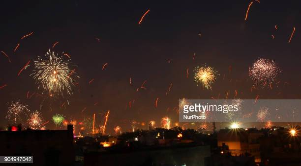 Fireworks after people flying kites on the occasion of Makar Sakranti at wall city of Jaipur, Rajasthan,India on 14 January 2018.