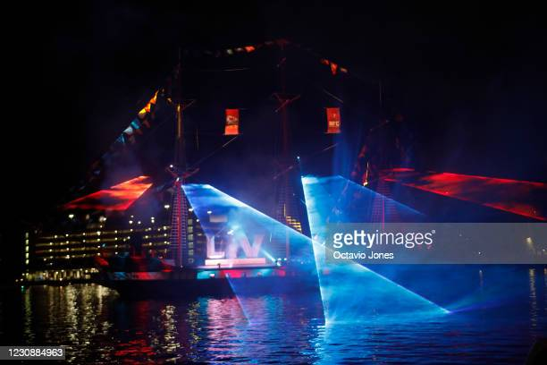 Fireworks and a laser light show from the Jose Gasparilla pirate ship light up the night sky in downtown Tampa at the start of Super Bowl LV...