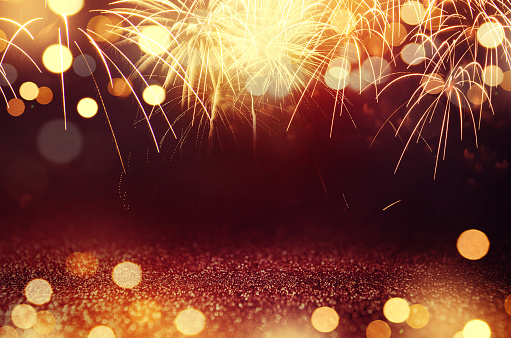 Fireworks and bokeh in New Year eve and space for text. Abstract background holiday. 875168596