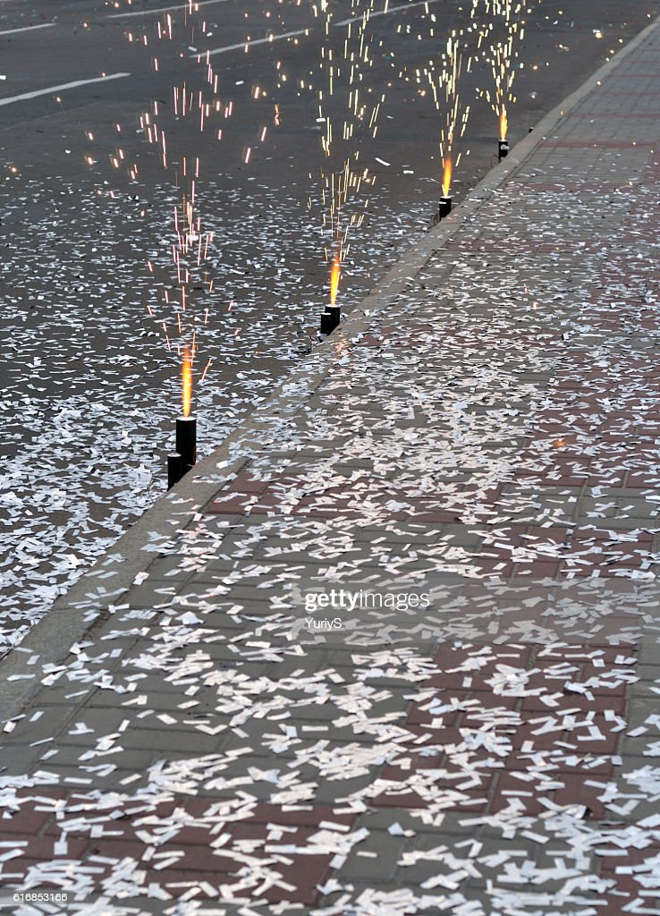 fireworks and  falling confetti : Stock Photo