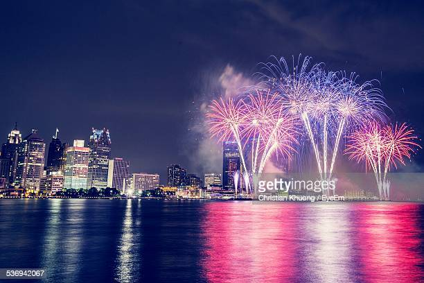 fireworks and illuminated city - happy independence day foto e immagini stock