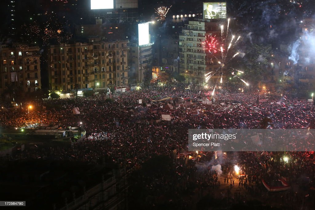 Fireworks and shouts of joy emanate from Tahrir Square after a broadcast by the head of the Egyptian military confirming that they will temporarily be taking over from the country's first democratically elected president Mohammed Morsi on July 3, 2013 in Cairo, Egypt. As unrest spreads throughout the country, at least 23 people were killed in Cairo on Tuesday and over 200 others were injured. It has been reported that the military has taken over the state television.