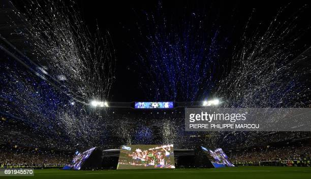 TOPSHOT Fireworks and streamers are set off at the Santiago Bernabeu stadium in Madrid on June 3 2017 to celebrate Real Madrid football team's after...