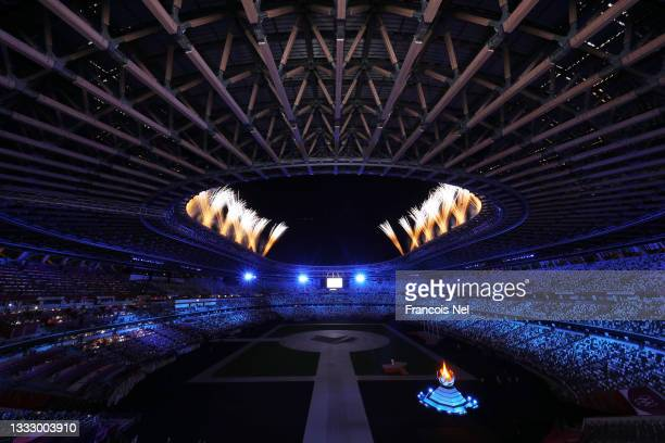 Fireworks and the Olympic Flame are seen during the Closing Ceremony of the Tokyo 2020 Olympic Games at Olympic Stadium on August 08, 2021 in Tokyo,...