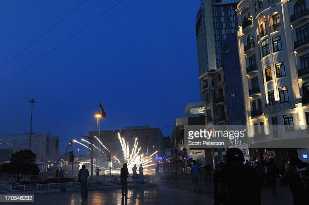 Fireworks are aimed at Turkish police as they battle antigovernment protestors to reestablish police control of Taksim Square after an absence of 10...
