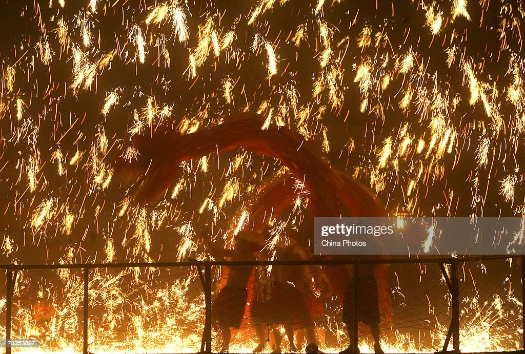 fireworks are displayed as a traditional dragon dance is performed during a celebration to mark the - Chinese New Year 2007