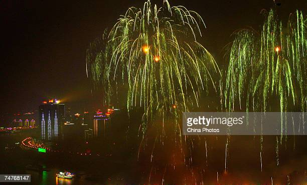 Fireworks are displayed at the Chaotianmen Gate the biggest harbor along the upstream of the Yangtze River during activities to mark the 10th...