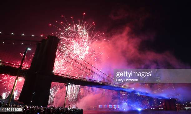Fireworks are launched from behind the Brooklyn Bridge during Macy's Independence Day fireworks show on July 4 2019 in New York City