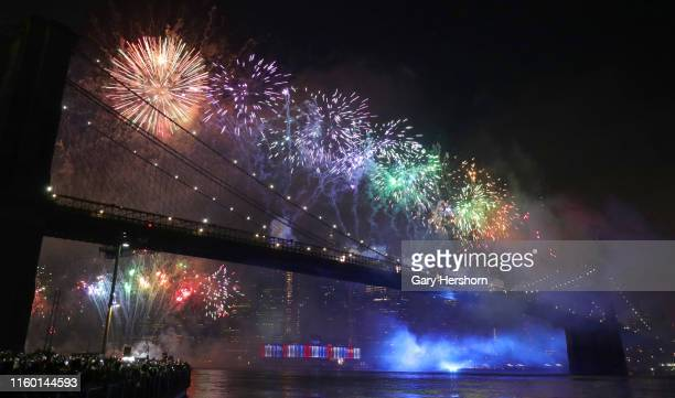 Fireworks are launched from the Brooklyn Bridge during Macy's Independence Day fireworks show on July 4 2019 in New York City