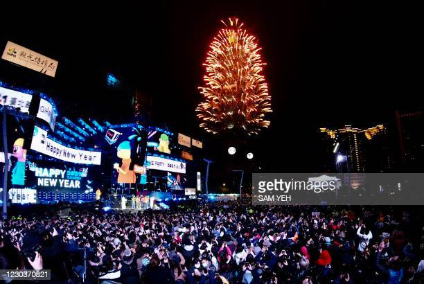Fireworks are launched from the Taipei 101 commercial building to celebrate the New Year in Taipei on January 1, 2021.