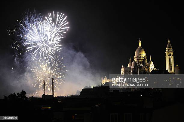 Fireworks are launched near the SacreCoeur Basilica on October 10 2009 as part of the Montmartre wine harvest festival in the northern district of...