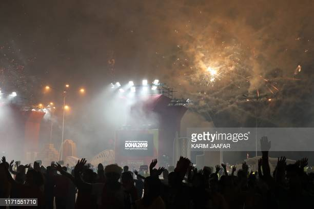 Fireworks are let off during the opening ceremony at the 2019 IAAF World Athletics Championships at the Khalifa International stadium in Doha on...