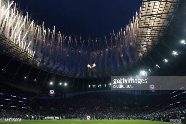 Fireworks are let off from the roof of the stadium during the opening ceremony ahead of the first Premier League game to be played at their new...