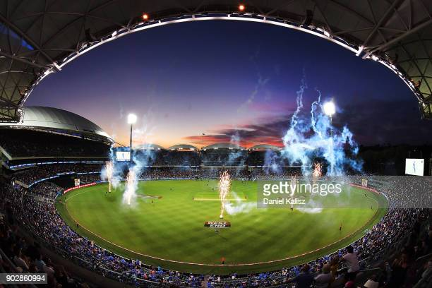 Fireworks are pictured as players walk onto the field during the Big Bash League match between the Adelaide Strikers and the Melbourne Stars at...