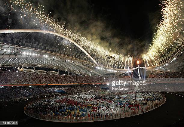 Fireworks are seen after the lighting of the cauldron during the opening ceremony for the Athens 2004 Summer Olympic Games on August 13, 2004 at the...