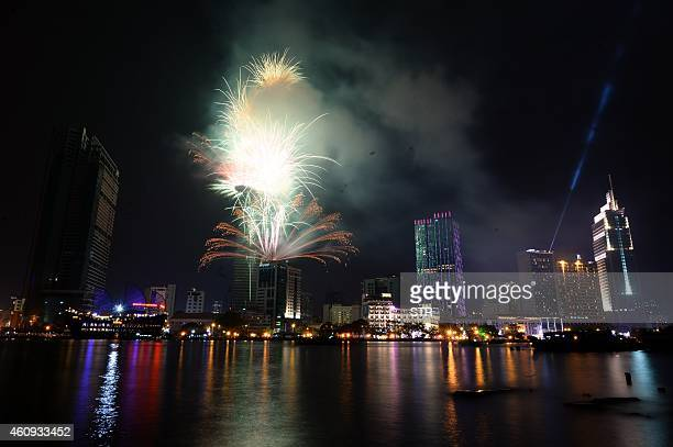 Fireworks are seen displayed from Betexco tower the tallest building at the financial district of Ho Chi Minh City for the New Year celebrations from...