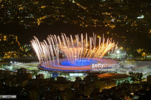 Fireworks are seen during a rehearsal of the opening ceremony of the Rio 2016 Olympic Games in Rio de Janeiro on August 3 2016 / AFP / YASUYOSHI CHIBA