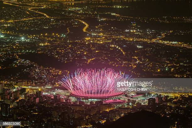 TOPSHOT Fireworks are seen during the Opening ceremony for Rio 2016 Olympic games at Maracana Stadium in Rio de Janeiro on August 5 2016 / AFP /...